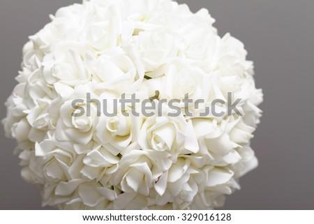 Photo of a beautiful white wedding bouquet - stock photo