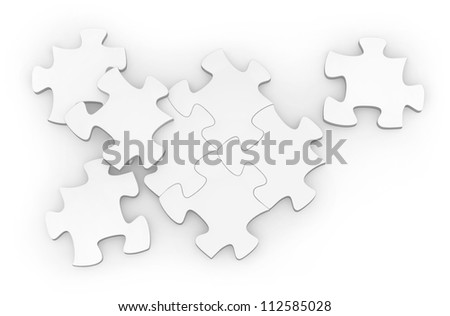 Photo of a blank jigsaw puzzle on a white back drop.