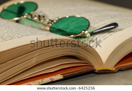 Photo of a Book and Glasses - Education Related