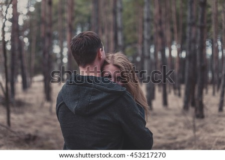 Photo of a boy and girl stand in the forest