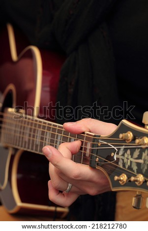 Photo of a boy who play the guitar