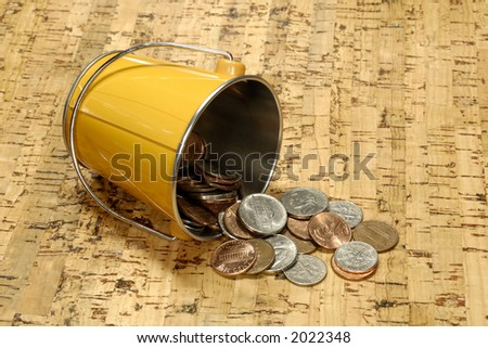 Photo of a Bucket With Cash - Bucket of Cash Concept - stock photo