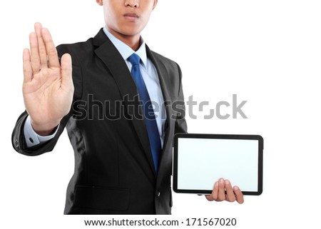photo of a businessman showing blank tablet PC monitor while pushing to virtual screen - stock photo