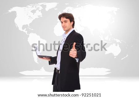 Photo of a businessman with a map of the world behind him