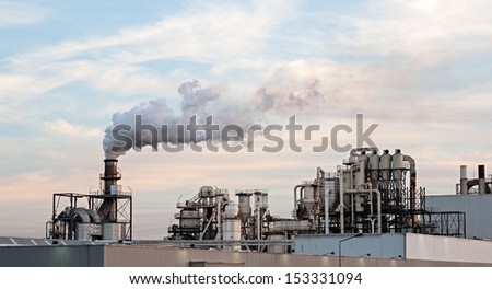 Photo of a cellulose / paper factory at sunset. Portugal. - stock photo