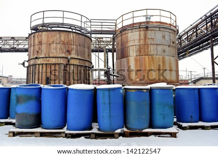 Photo of a Chemical waste dump with a lot of barrels