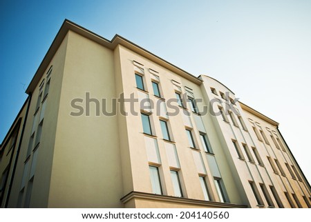 Photo of a clean block of flats from the bottom. Classical architecture business building. - stock photo