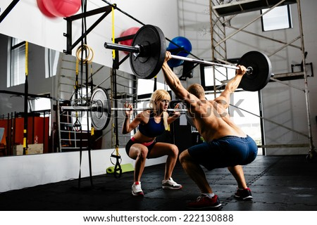 Photo of a couple of weightlifters training together with barbells - stock photo