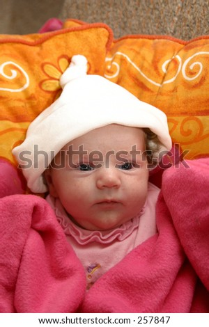 Photo of a cute baby with a beanie on.