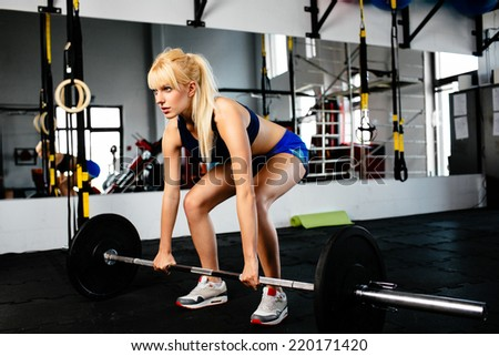 Photo of a female during a weightlifting session - stock photo