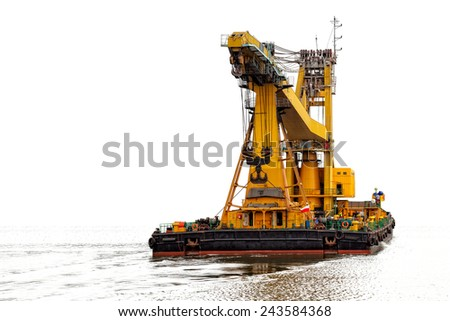 Photo of a floating crane isolated on white background. - stock photo
