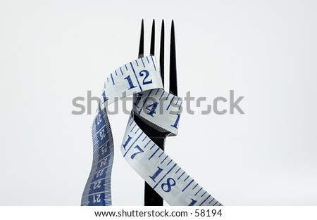 Photo of a Fork and Tape Measure.  Diet Metaphor
