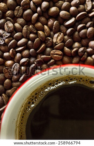 Photo of a fresh coffee and coffee beans from above - stock photo