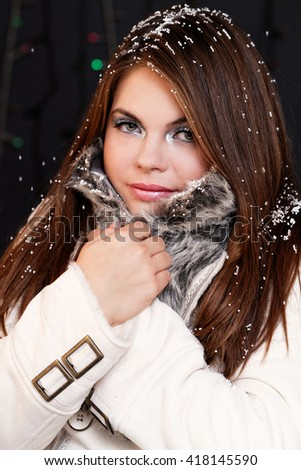Photo of a girl in coat at winter - stock photo