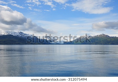 Photo of a glacier retreating from the ocean. Taken from water - stock photo