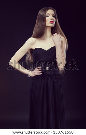 photo of a glamour woman wearing black evening dress - stock photo