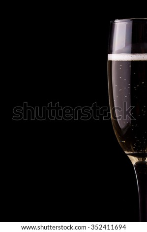 Photo of a glass of champagne on black background