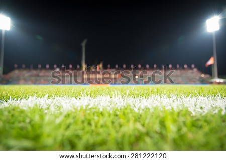Photo of a green synthetic grass sports field with white line shot - stock photo