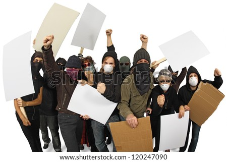 Photo of a group of angry protesters wearing masks and holdings signs. Shot with Fisheye lens with focus on middle people. - stock photo