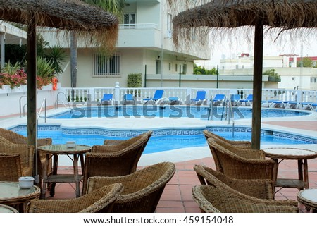 Photo of a hotel's swimming pool with parasols in Spain, Torremolinos.