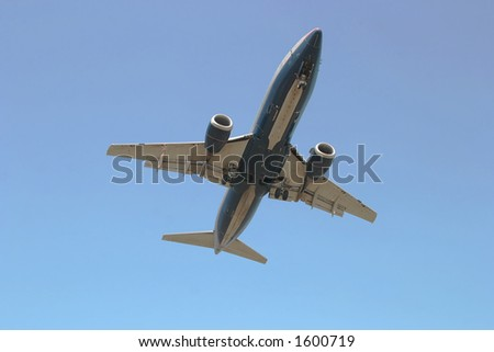 Photo of a jet airliner as it is passing overhead and about to land