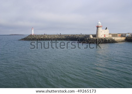photo of a lighthouse on the  Ireland coast