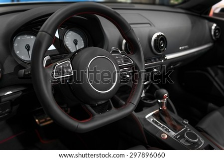 Photo of a Luxury car interior with steering wheel - stock photo