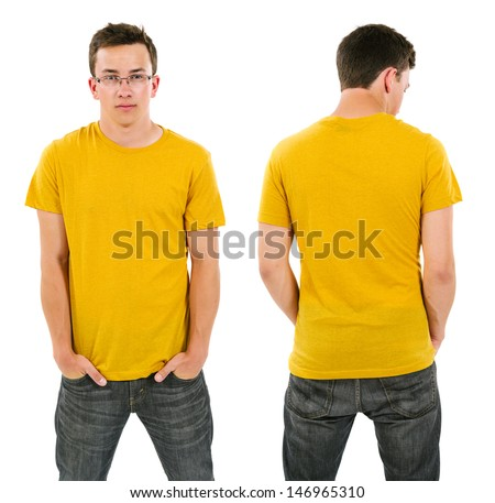 Photo of a male in his late teens posing with a blank yellow shirt.  Front and back views ready for your artwork or designs. - stock photo