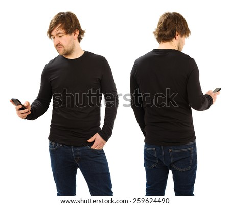 Photo of a man holding a smartphone and wearing a blank black t-shirt, front and back. Ready for your design or artwork.  - stock photo