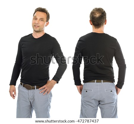 Photo of a man posing with a blank black long sleeve shirt, ready for your artwork or design.