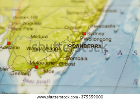 Photo of a map of Australia and the capital Canberra . - stock photo