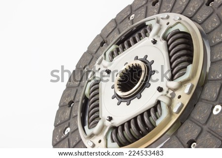 Photo of a new clutch plate isolated on grey background. car parts