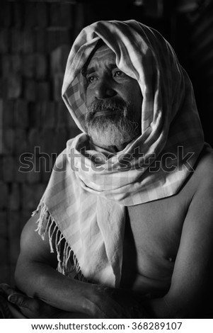 Photo of a old Asian man with a very caracterful face in Black and white