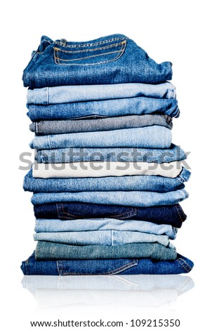 Photo of a pile of old worn blue and white jeans - stock photo