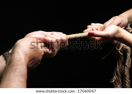 photo of a rope with hand pulling