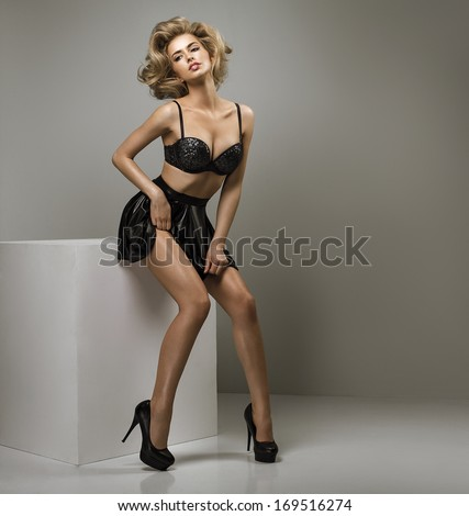 Photo of a sexy blond woman - stock photo