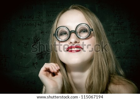 photo of a sexy female nerd with funny glasses
