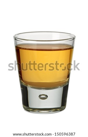 Photo of a shot glass filled with whiskey or bourbon.