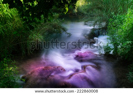 Photo of a small creek on the slow shutter and using darker filters.