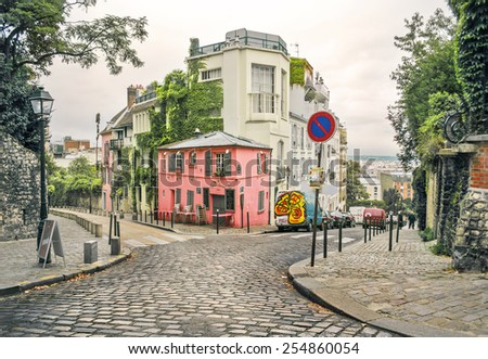 photo of a street in Montmartre, Paris, France, in a warm light and light toning - stock photo