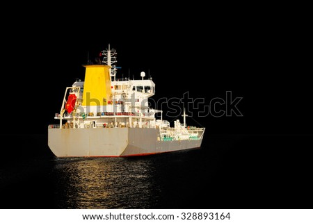 Photo of a tanker ship isolated on black background.