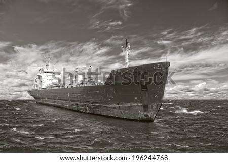 Photo of a tanker ship on sea in black and white tone. - stock photo