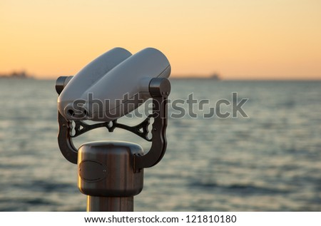 Photo of a tourist binoculars next to the sea in Trieste - stock photo