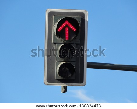 Photo of a traffic sign with a red arrow displayed