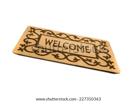 Photo of a welcome door mat isolated on a white background.