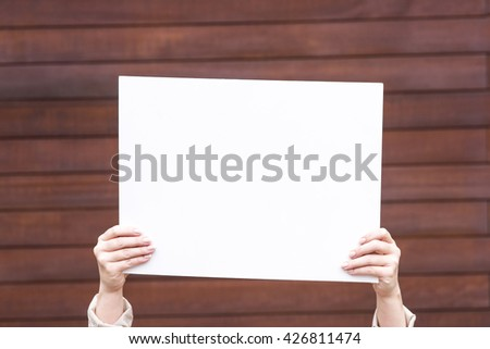 photo of a woman on the outside with an empty white card