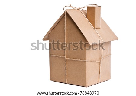 Photo of a wrapped house in brown recycled paper, cut out on a white background. - stock photo