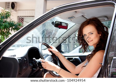 Photo of a young and beautiful woman in the car