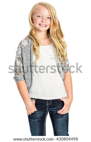 Photo of a young blonde girl in blue jeans, white t-shirt and gray sweater; isolated on white. - stock photo