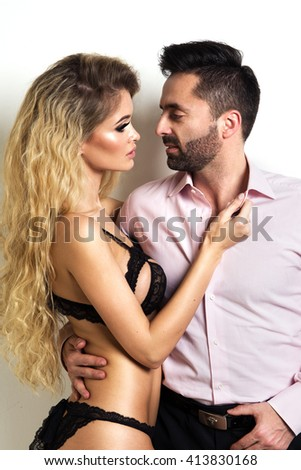 Photo of a young couple. Woman in sensual lingerie and elegant man